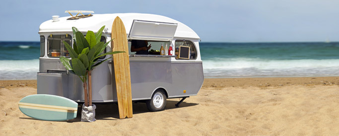caravan-beach-surf-board